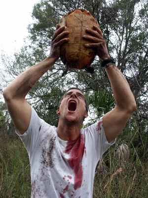 Bear drinking turtle blood - man-vs-wild Photo