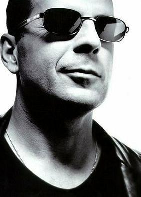 Bruce Willis in sunglasses.