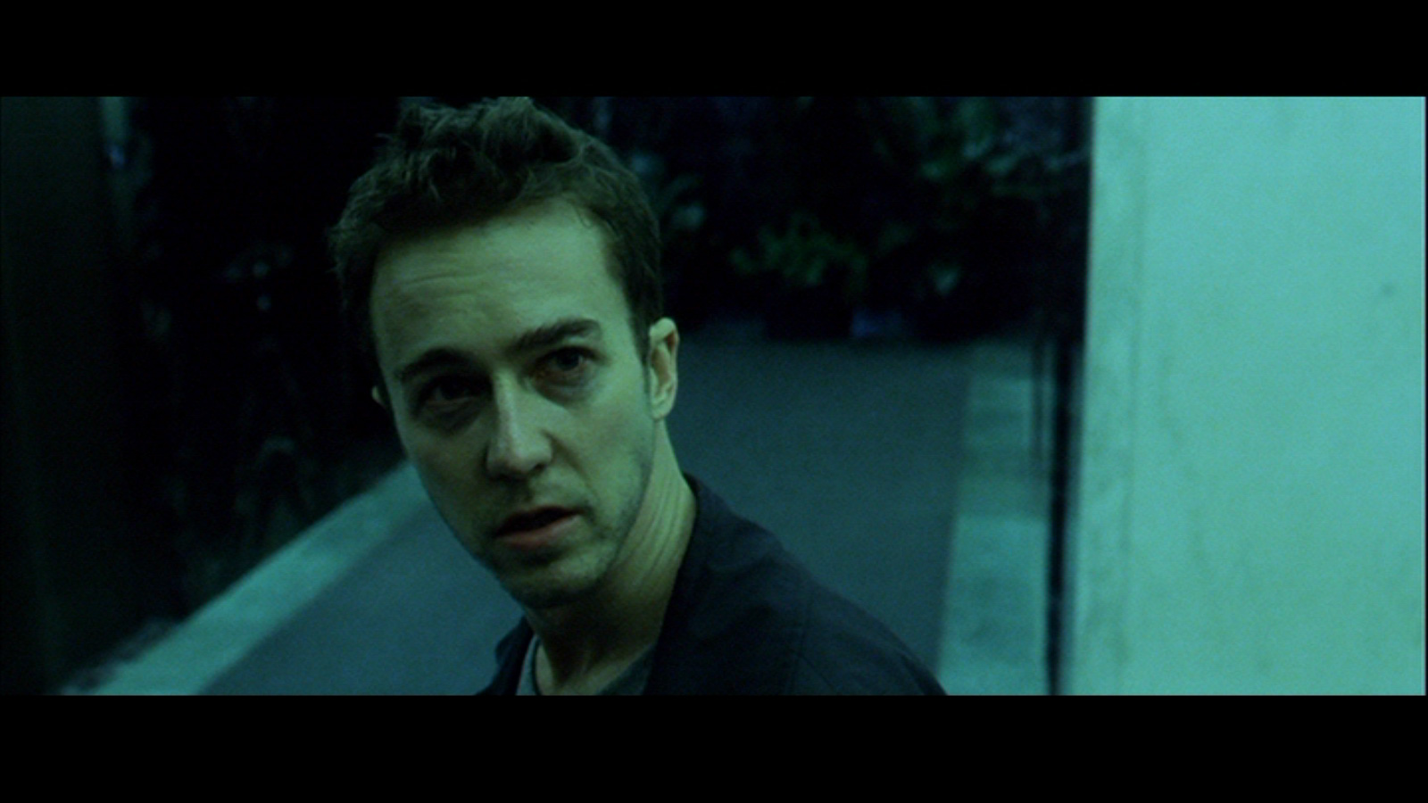 movie fight club essays Fight club tells the story of an everyday man who wanders from the safety of his nine-to-five life into a no-man's-land of violence and social destruction the protagonist, played by edward norton, is a white-collared american nobody who joins an under.