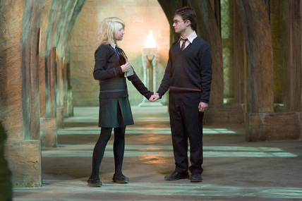 Harry Potter and Luna Lovegood holding hands in one of the HP movies