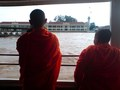 Monks on river boat
