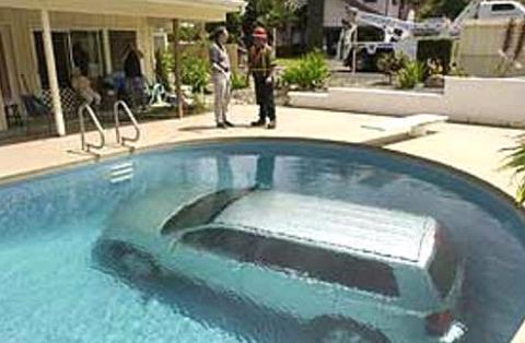 car in the swimming pool