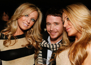 Kevin Connolly enjoys the company of two lovely blondes at the Hawaiian Tropic Zone