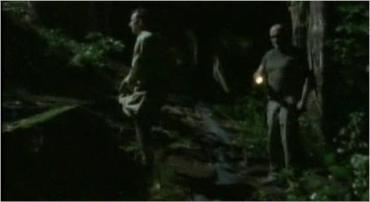 Locke walking with someone (Ben?), turns to shine his flashlight on someone au something...